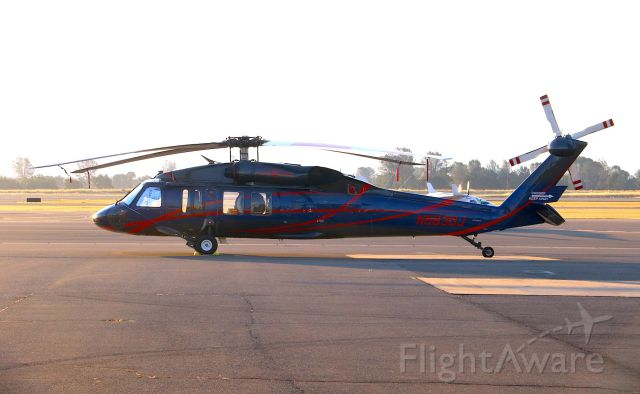 Sikorsky S-70 (N563DJ) - KRDD - Civilian/or Contract Blackhawk Fire fighting Helo on the ramp at Redding, CA July 16, 2018 during fire season -