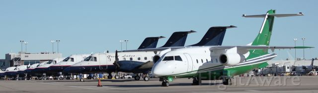 Fairchild Dornier 328JET (N259DS) - Key Lime Dornier in front of a bunch of Great Lakes Embraers and Beechcrafts.