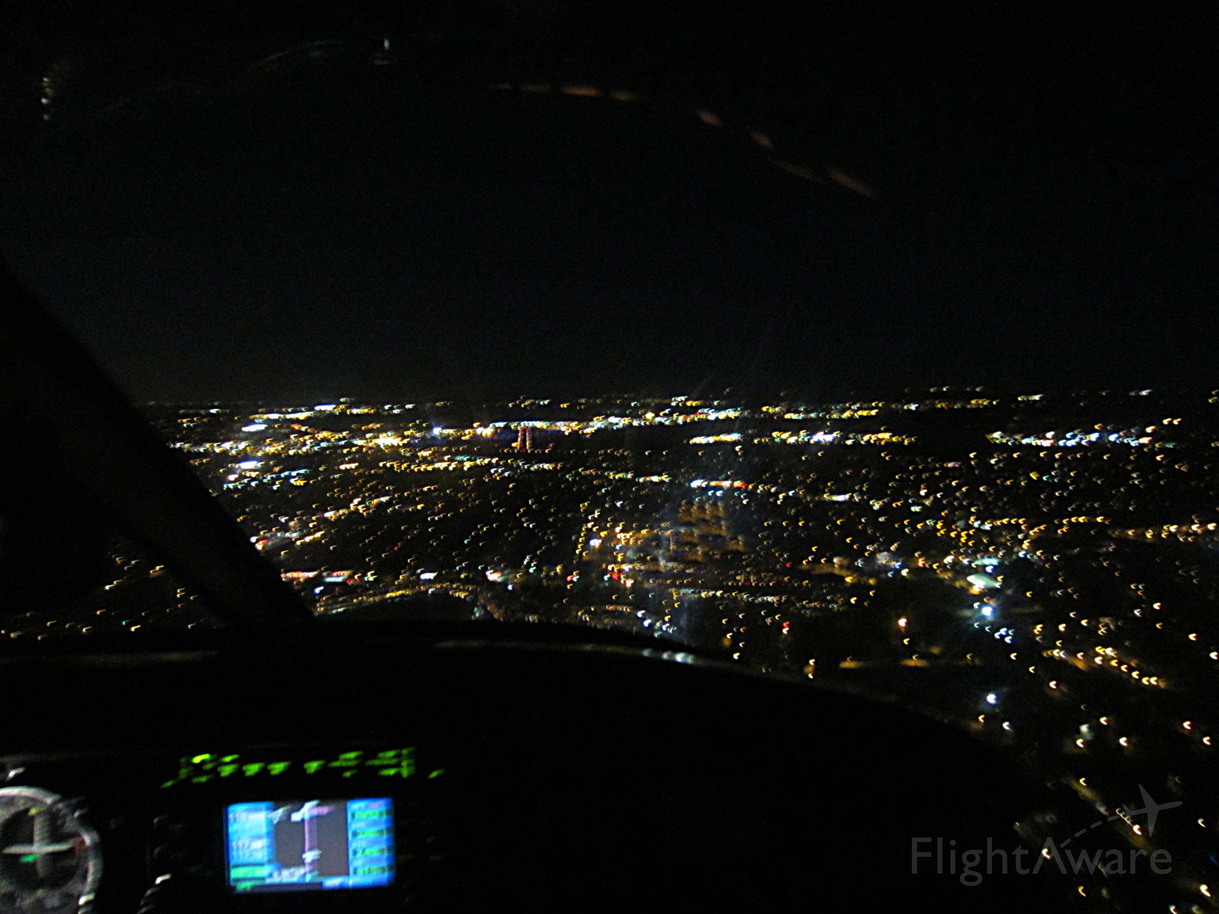 Piper Cherokee (N80FG) - Night GPS approach,, I like the visual of the runway lined up with the GPS.. sorry my Right Seat took a blurry shot but she does love to fly with me ::)))