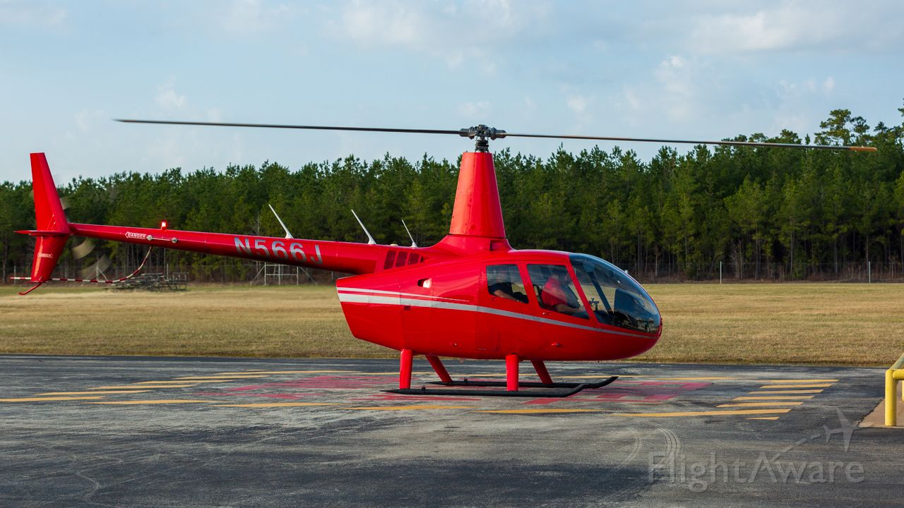 Robinson R-66 (N566J) - Fueling up before heading south out of Nacogdoches.