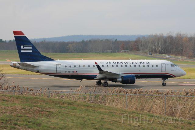 Embraer 170/175 (N129HQ) - Republic ERJ-175 holding short of runway 24.