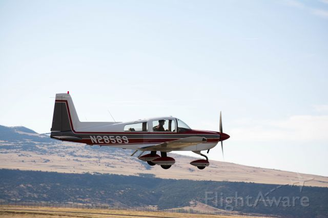 Grumman AA-5 Tiger (N28569) - Watching the traffic in Raton on a Mountain flying trip with my flight school yielded some pretty amazing photos.