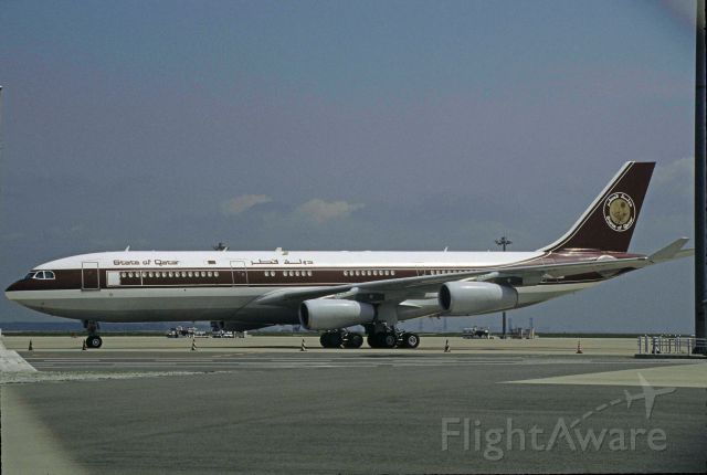 Airbus A340-200 (A7-HHK) - Parked at Tokyo-Haneda Intl Airport on 1999/04/20