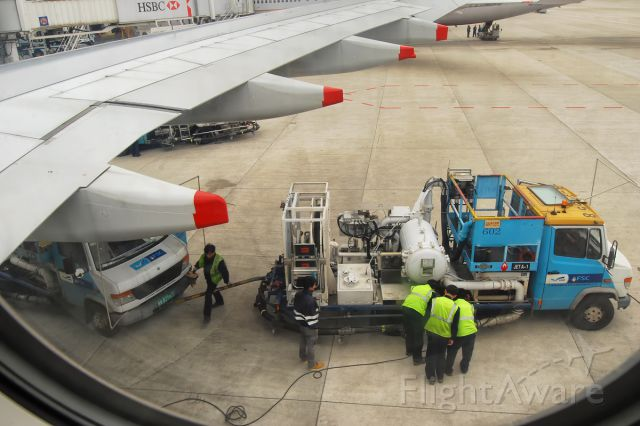 Airbus A330-300 (9M-MTG) - 11th April, 2014.  My flight from Shanghai to Kuala Lumpur was delayed because the fuel truck broke down under the wing.  A new truck had to be brought in to tow it away.