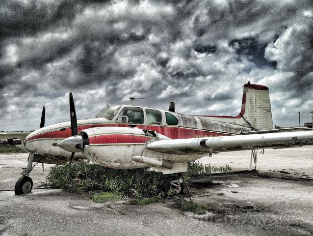 Beechcraft Travel Air (N102SF) - How many stories could this old T-Bone tell?  Rest in peace old bird... at Saipan Intl.