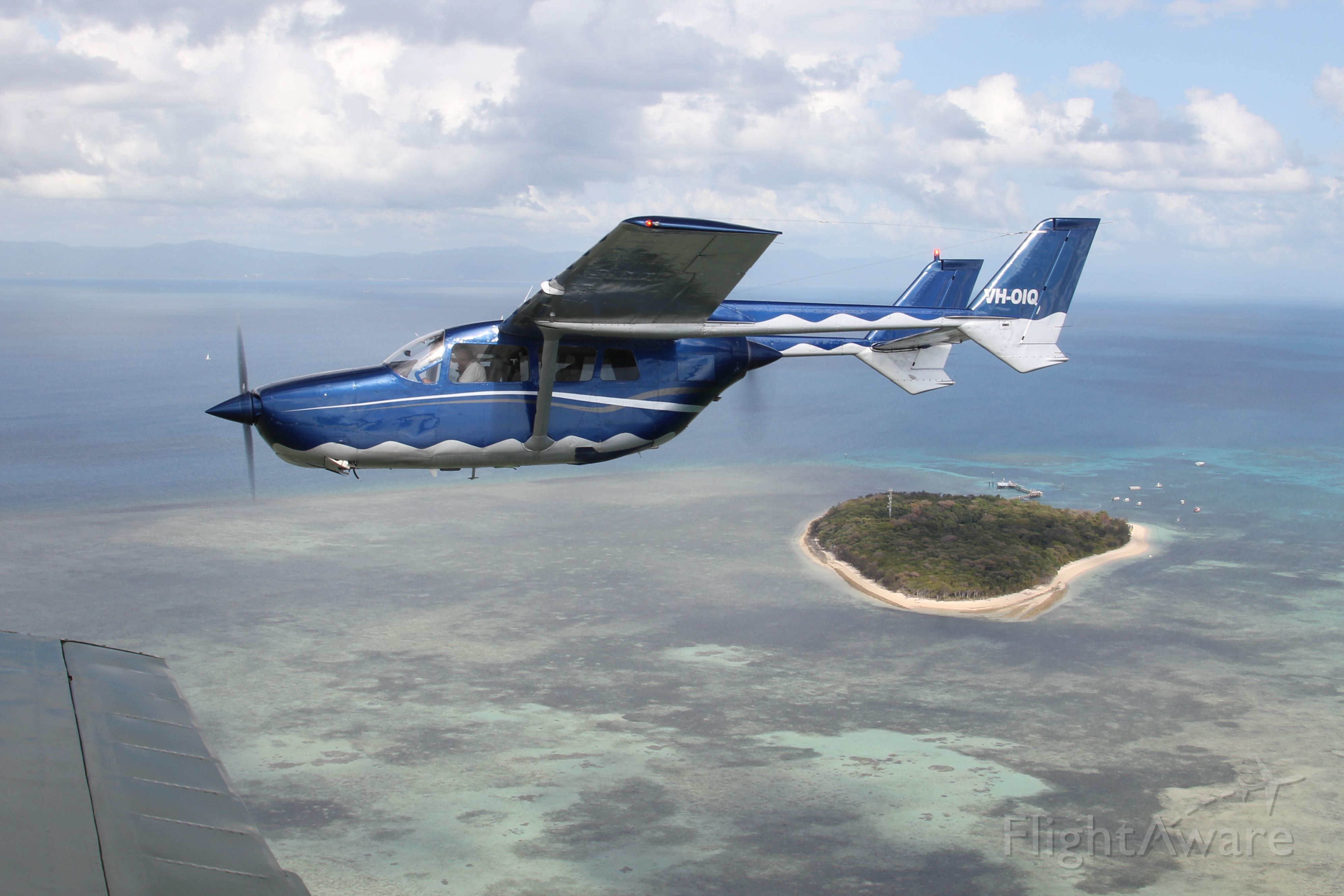 Cessna Super Skymaster (VH-OIQ) - Reef scenic flight over Green Island, Great Barrier Reef with OutbackOvernight.com