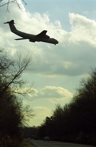 Lockheed C-141 Starlifter — - On final to McGuire Air Force Base.  October 1999.