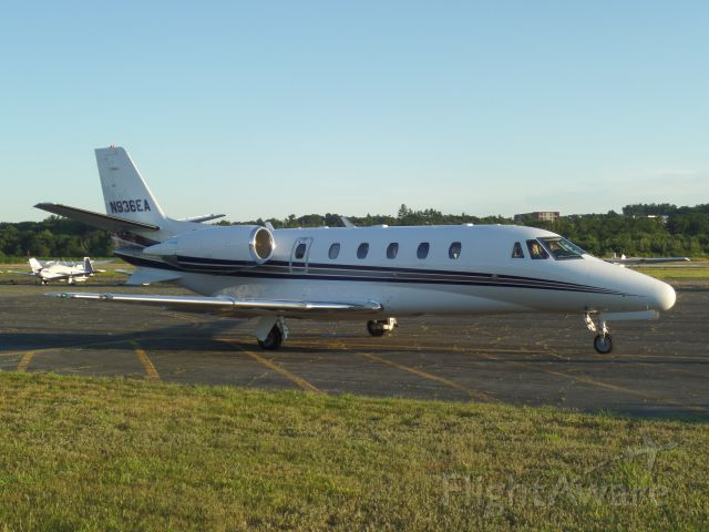 Cessna Citation Excel/XLS (N936EA) - Parked after arriving from Indianapolis, IN (KIND).