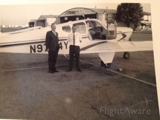 Beechcraft Bonanza (33) (N9704Y) - 1964 photo in front of Greensboro-High Point Air Service after airplane was delivered to new owner. Aircraft destroyed 8/23/2015 on approach to Eldorado, Arkansas. See NTSB report CEN15FA374