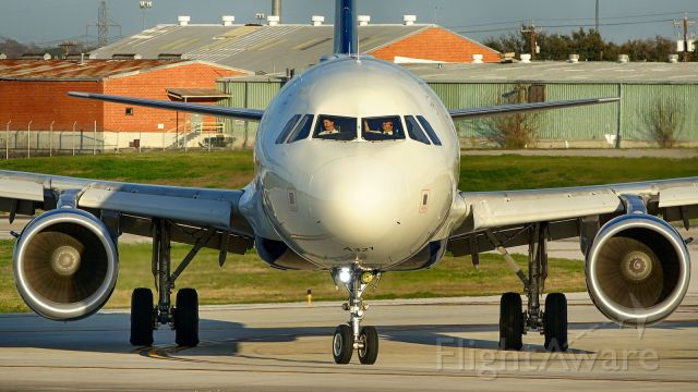 Airbus A321 (N314DN) - Exiting 4 at N6 after arrival.