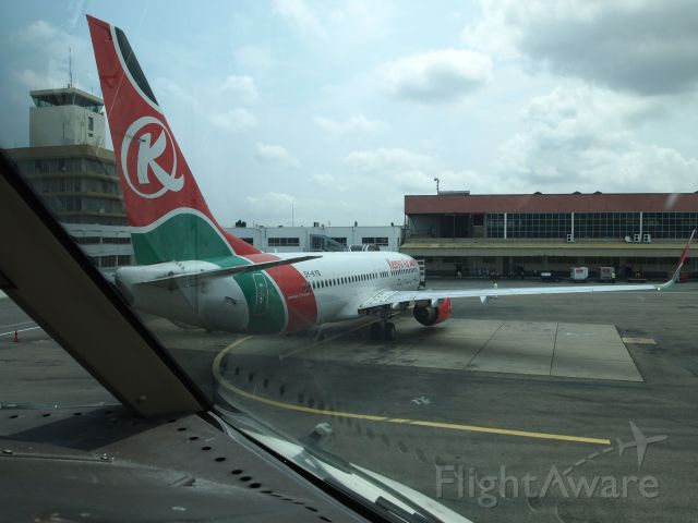 Boeing 737-700 (5Y-KYB) - This is a Kenya Airways Boeing 737-800 that was starting engines to taxi as we waited to off load.