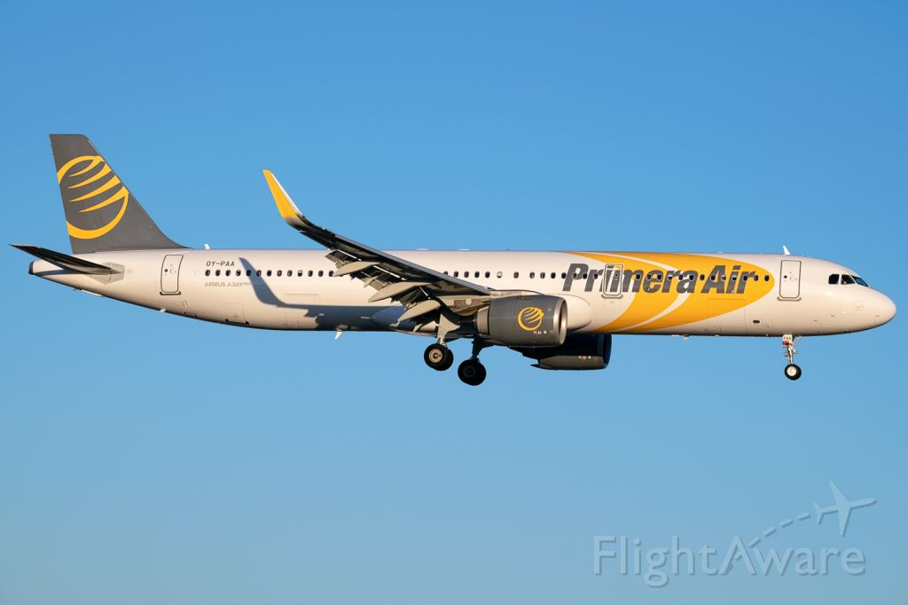 Airbus A321 (OY-PAA) - On a beautiful summer evening, the new Airbus A321Neo  operated by Primera Air lands at Totonto Pearson (YYZ) from London Stansted (STN). July 7, 2018.