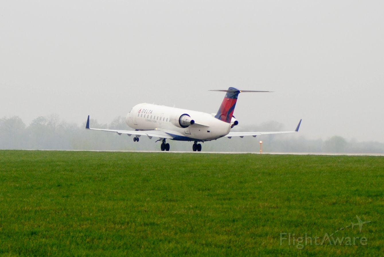 Canadair Regional Jet CRJ-200 (N8965E) - Taking off runway 23 from Des Moines, Iowa to Detroit, Michigan.