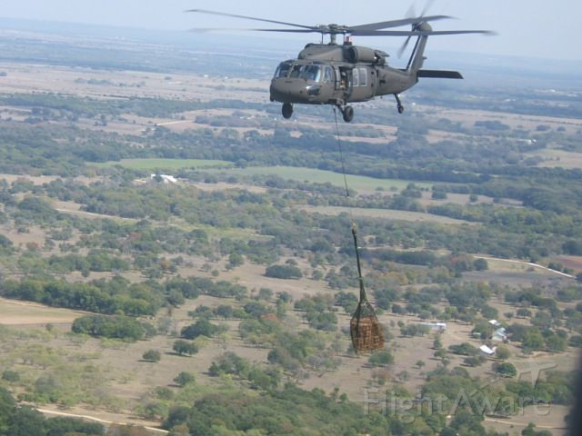 — — - My unit was selected to test the UH-60M before the official roll out to the entire Army. This was me crewing on a hawk slinging MREs for troops in the field.