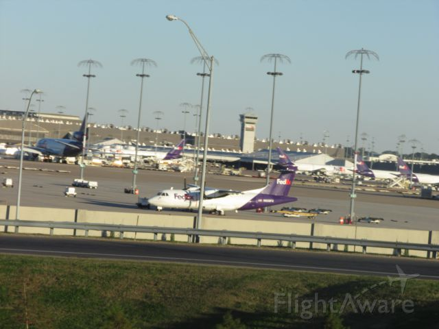 N920FX — - Sitting on the tarmac with all the md-11 and dc-10 and a300 in the background