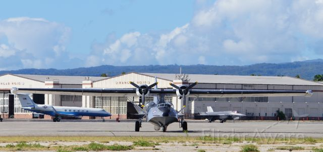 """N9767 — - The distinctive and instantly recognizable shape of a PBY-5A named """"Princess of the Stars"""" sits on the ramp at historic Hickam Air Base with a F-35 in the background.  """"Princess of the Stars"""" was on O'ahu with 13 other warbirds to commemorate the 75th Anniversary of  VJ Day, conducting flyovers and more.  The daily sounds of her engines flying over my house for the past three weeks will be greatly missed."""