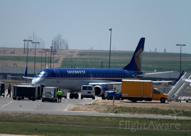 Embraer 170/175 (N171HQ) - I took this at Denver International while waiting to board a jet to Rapid City, SD. I have no idea what they were doing. Filming a commercial or movie maybe?