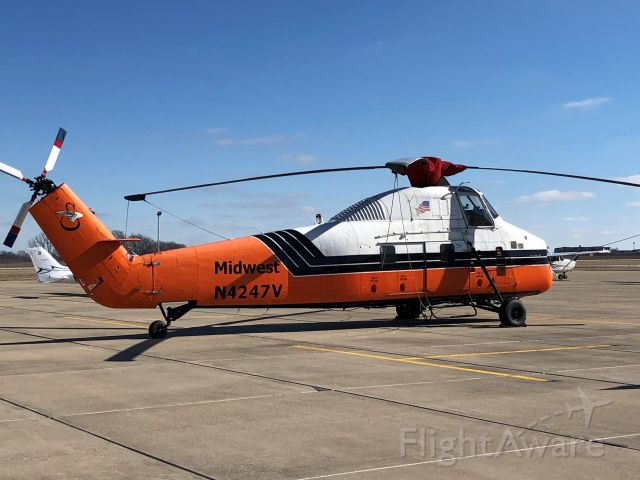 Sikorsky S-58T (N4247V) - Parked on the ramp at Indianapolis Metro - KUMP. Used as an aerial crane for construction projects (e.g. lifting industrial size AC units on commercial facility roofs)
