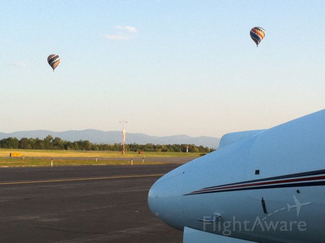 Cessna Citation X (FIV702) - Sunday Morning with Balloons in the background