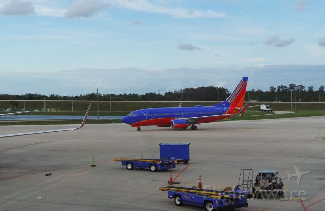 Boeing 737-700 (N7734H) - Southwest 3968 departing MCO for ATL