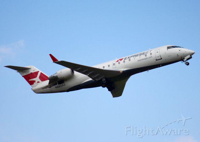 Canadair Regional Jet CRJ-200 (N884AS) - At Shreveport Regional. 2001 Bombardier CRJ-200ER (CL-600-2B19)