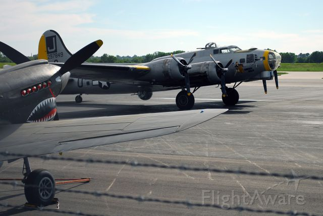 Boeing B-17 Flying Fortress (N390TH) - Liberty Belle parked at Wheeler Downtown Airport in Kansas City, MO with a P-40 in the foreground. This picture was taken on May 22, 2011. This aircraft crashed on June 13, 2011 and was a total loss.