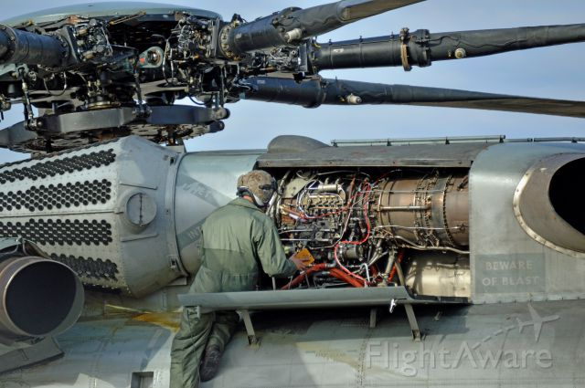 — — - A Marine Corps CH-53 Super Stallion from McGuire AFB sits at Niagara Falls International Airport being repaired. They did not have the right part to fix it so another super stallion was dispatched to deliver the part.