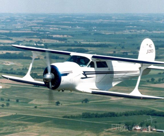 Beechcraft Staggerwing (N52931) - Beech Staggerwing flown over the Wisconsin countryside.  Flown by Dick Wixom.  Photo by Larry Wixom
