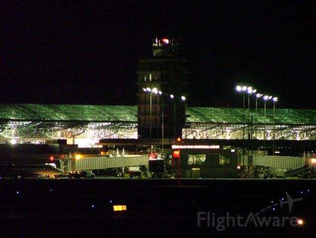 — — - Night shot of ATC tower and main terminal.