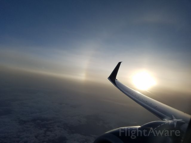 Boeing 737-900 — - Sundog off the wingtip of the Delta 737 coming into ATL.