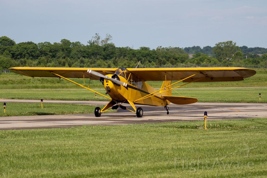 Piper NE Cub (N6337H) - Mr. Hogan's Piper J-3 Cub taxiing for Runway 11 at Butler Co. Regional Airport.