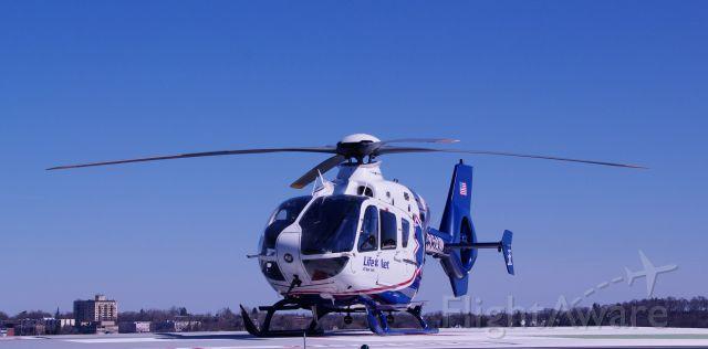 N235AM — - Roof top helipad SUNY Upstate University Hospital