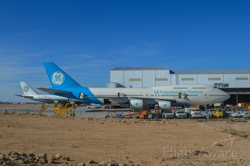 Boeing 747-200 (N747GE) - 2 GE 747s that are used to test new aircraft engines. Note the 747 in the rear with the old GE paint scheme. SCLA Victorville CA