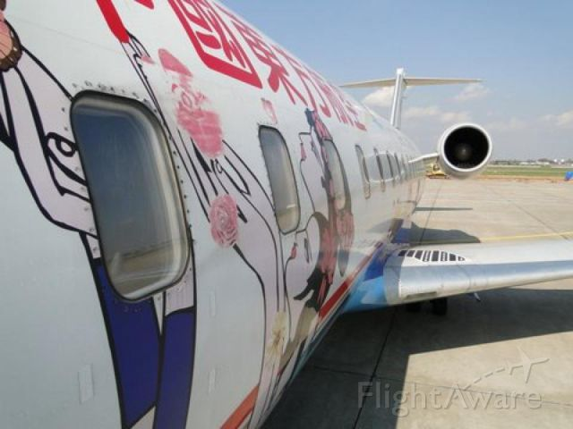 — — - Was just about to board this plane in Kunming, China for a short flight down to Vientiane, Laos (Jan. 2012).