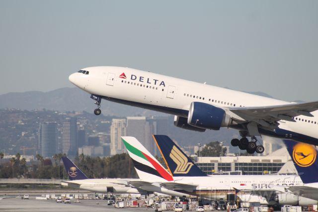 Boeing 777-200 (N710DN) - Blasting Out Runway 25R