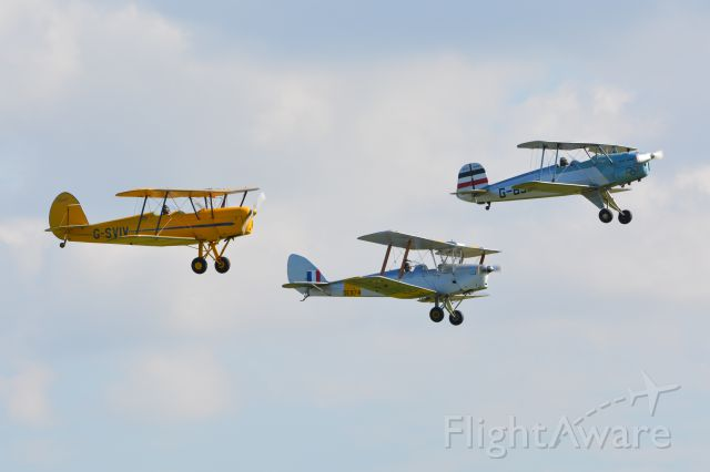 MULTIPLE — - From left: Stanpe SV4c, De Havilland DH82A Tiger Moth and Bucker Bu131 Jungman at Duxford Air Show on 20 September 2015.
