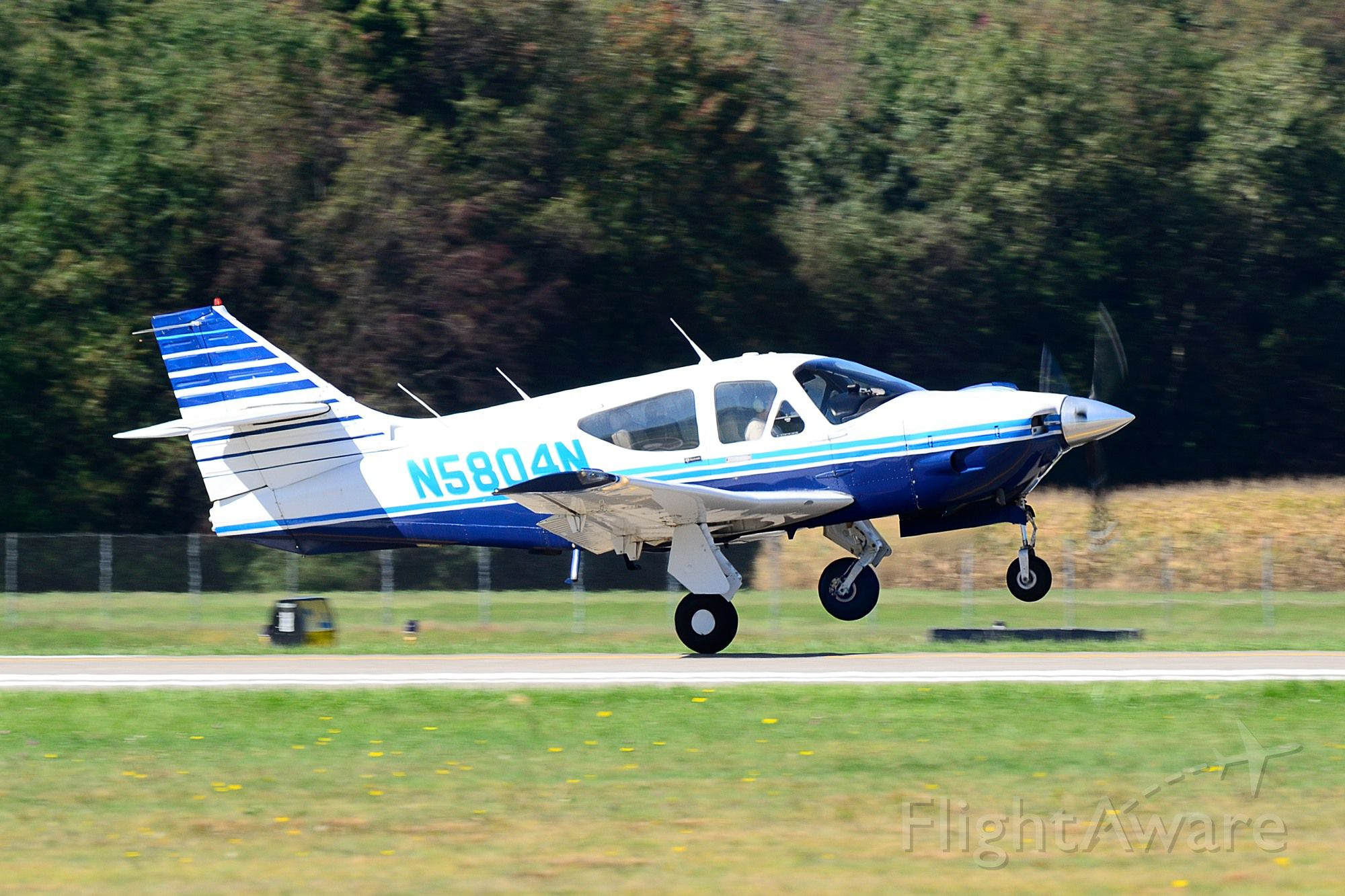 Rockwell Commander 114 (N5804N) - Departing Runway 8