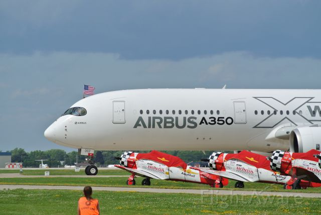 Airbus A350-900 (F-WWCF) - American Flag flying out of the Airbus A350 at Air Venture 2015 after arrival