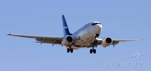 BOEING 737-600 (C-GWSK) - Westjet Boeing 737-600 on final at CYXE.