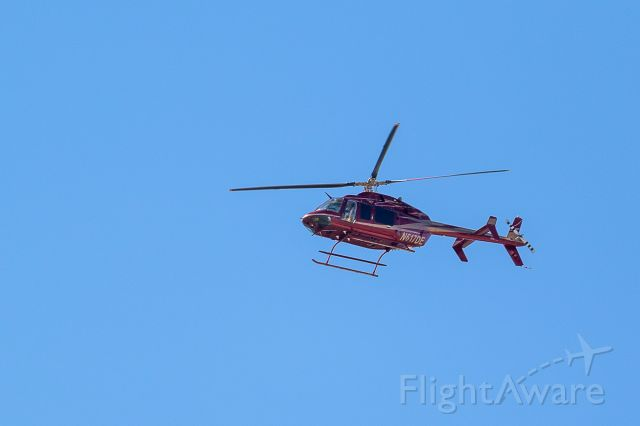 Bell 407 (N617DE) - Seen over Loveland, Colorado 9/10/2018.