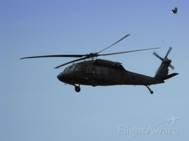 UNKNOWN — - This  Military Chopper made a pass by the Airport and have no clue as to the make.  Best guess is our Reserve Guard Units are out for manuevers on this nice day in the Spring of 2012.