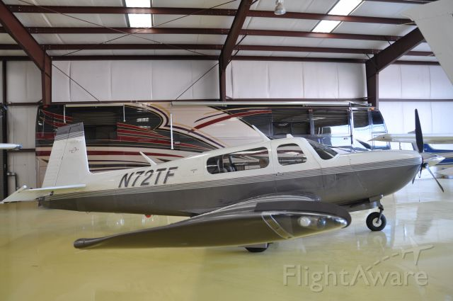 Mooney M-20 (N72TF) - In the hangar looking at the nice paint job on this speed demon.