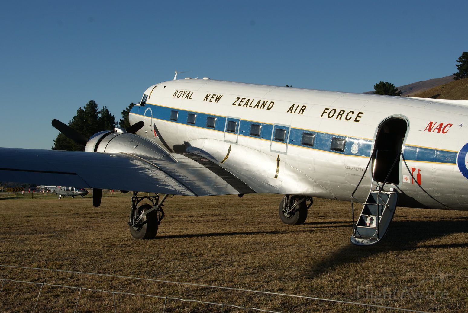 Douglas DC-3 (ZK-DAK) - Basking in the sun on a beautiful Wanaka morning prior to the start of the Warbirds Over Wanaka airshow.
