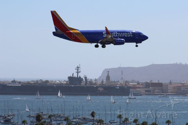 BOEING 737-300 (N643SW) - Landing 27 with carrier, boats, and bay in background