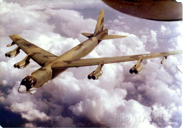 Boeing B-52 Stratofortress (N6511) - I snapped this pix when the B-52G was leaving the boom after a successful air refueling.   I was flying out of TRAVIS at the time.... right around 1980.  I loved the paint job.    Puffy clouds really make the picture!