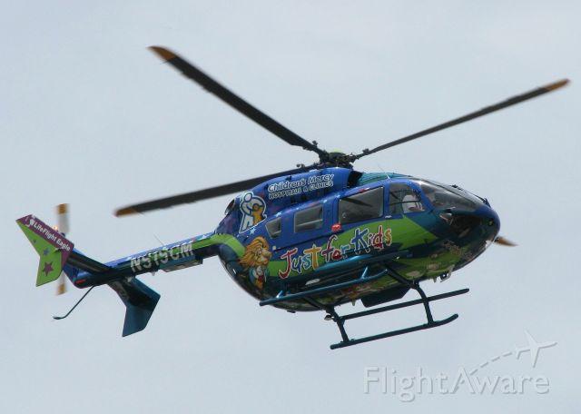 KAWASAKI EC-145 (N919CM) - Leaving Downtown Shreveport.