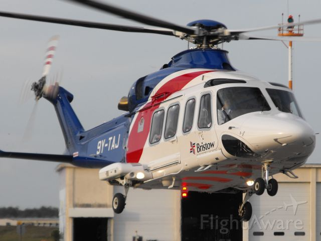 BELL-AGUSTA AB-139 (9Y-TAJ) - Bristow helicopter hover taxi to the pads