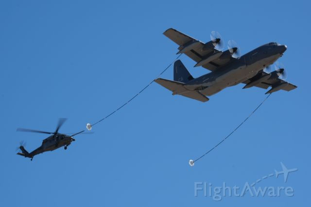 Lockheed C-130 Hercules (SIKORSKY) - Demonstration of Special Operations. HH-60G carrying USAF Pararescue airmen hits the tanker nip of a C-130 at approximately 1,000ft AGL. Low level stuff my 172 hides from.
