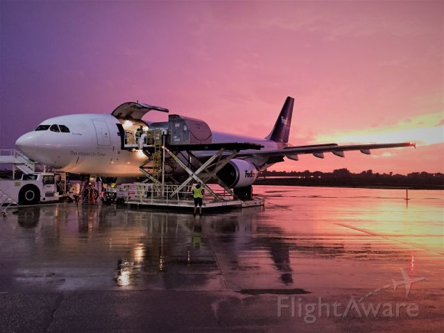 """Airbus A300F4-600 (N686FE) - Cargo Loading underway for one of the fleet's Airbus work horses.....""""Sara Reye"""" .<br /><br />The storm has moved on so we are A-Go for departure."""