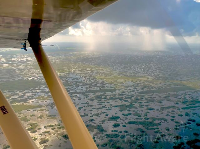 Piper 108 Voyager (N743C) - Florida Everglades summer showers